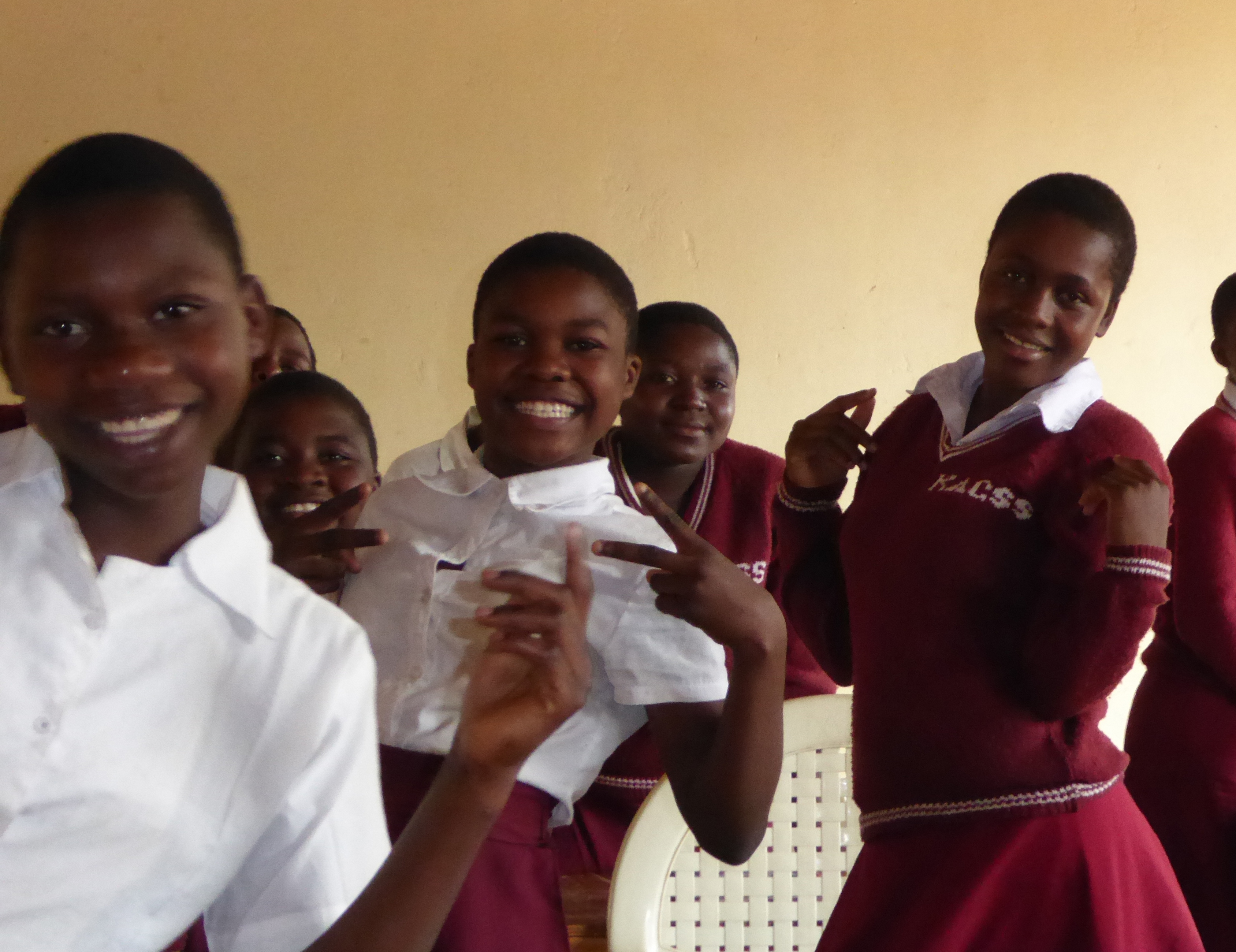 Karonga girls are delighted to pose for the camera