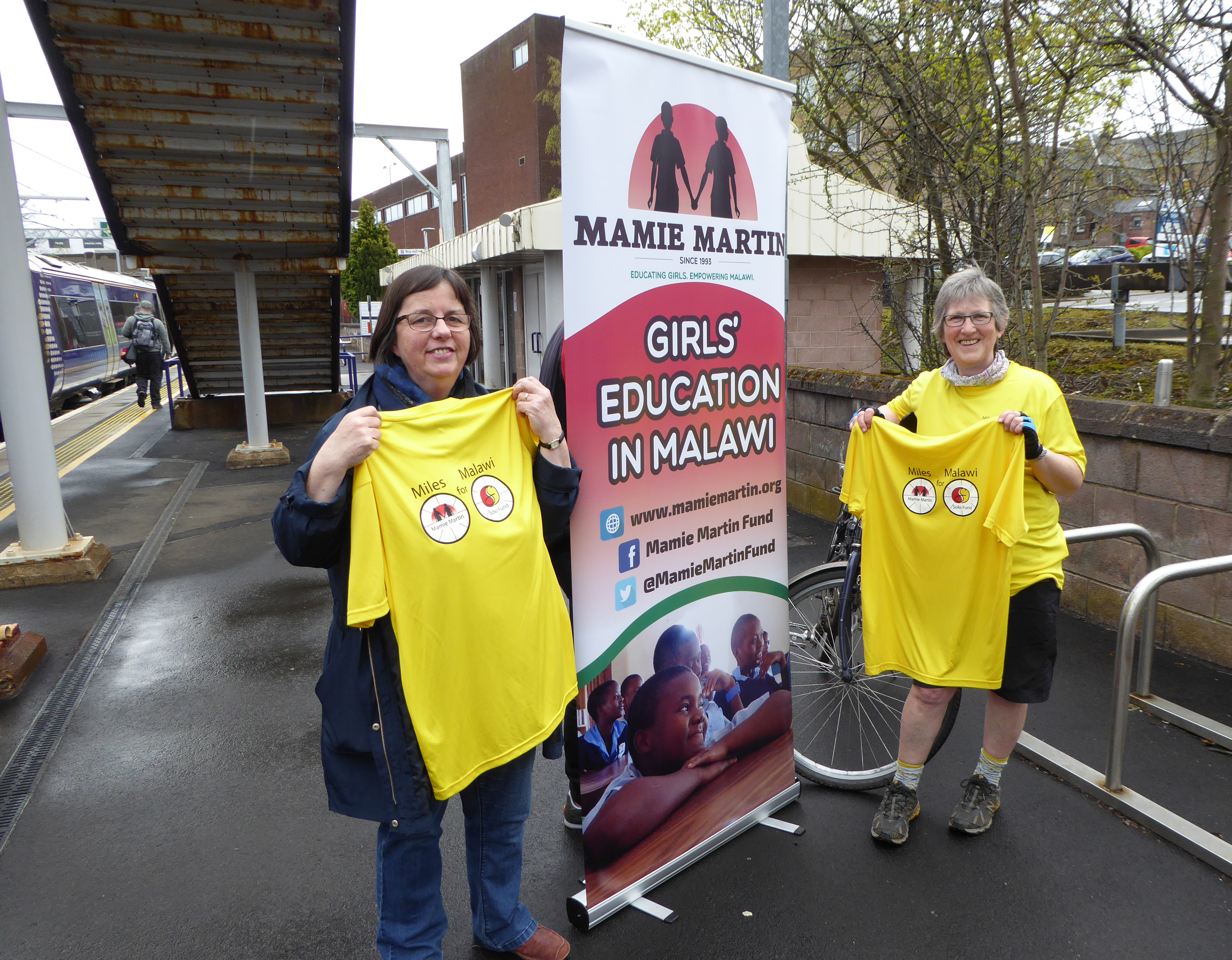 Mariot and Moira-Handover of cyclist's tee-shirts